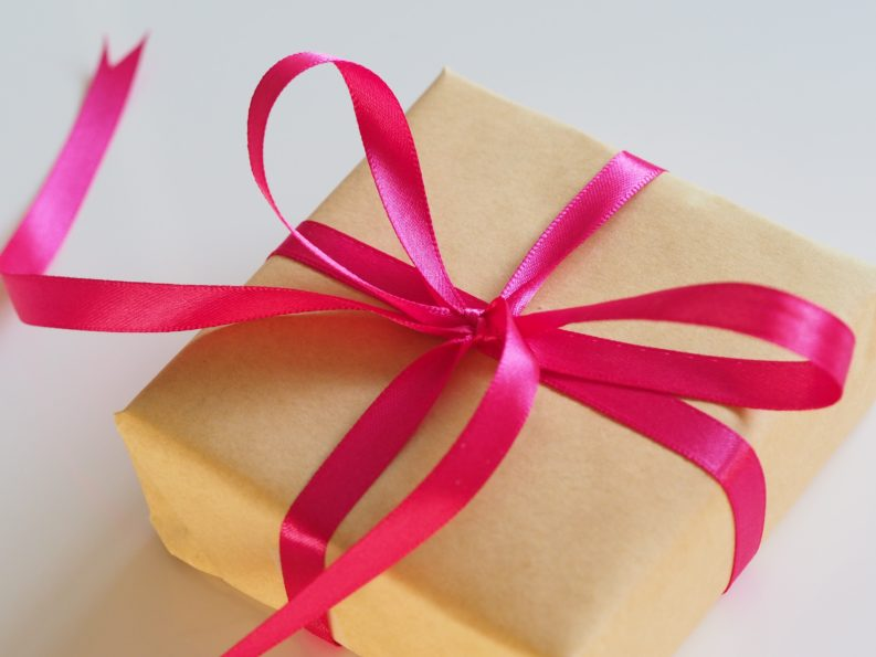 unopened gift with pink ribbon
